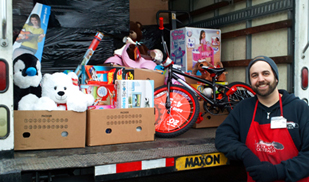 Travis Brant with toys for the children